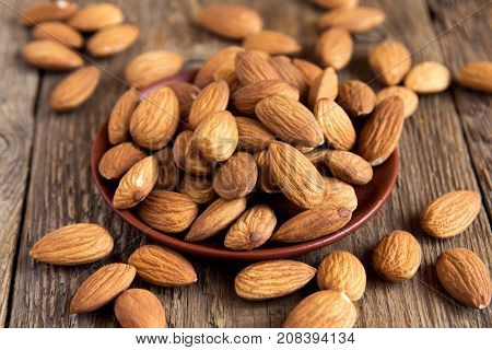 Almonds over rustic wooden background. Almond nuts.