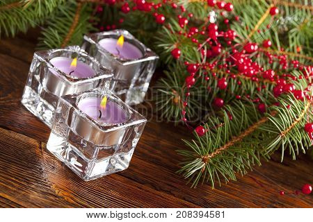 Three Christmas Candles And Branch Of Xmas Tree
