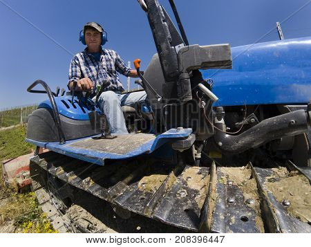 Driver On Crawler Tractor Viewed From Below