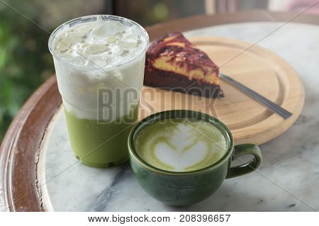 Green Tea Frappucino In Takeaway Cup And Cheesecake On The Marble Background