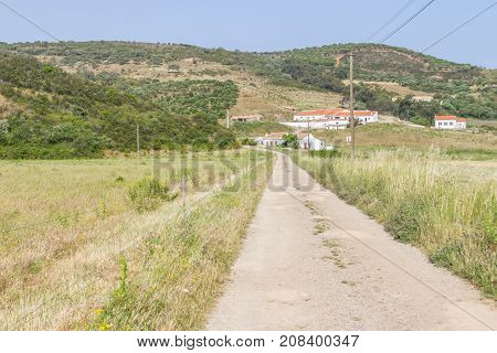 Farm Road In Carrapateira With Mountain, Houses And Vegetation