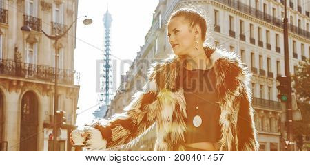 Modern Woman In Fur Coat In Paris, France Looking Into Distance