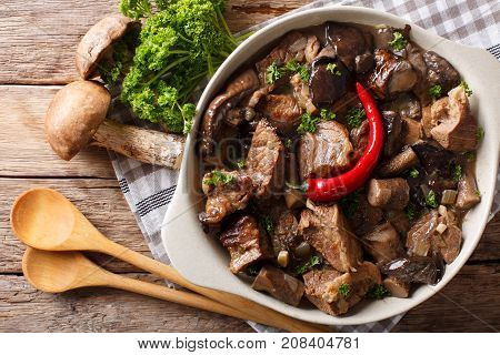 Beef Stew With Wild Mushrooms, Onion And Chili Pepper Close Up In A Bowl. Horizontal Top View