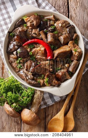 Stew Beef With Wild Forest Mushrooms And Chili Close-up. Vertical Top View