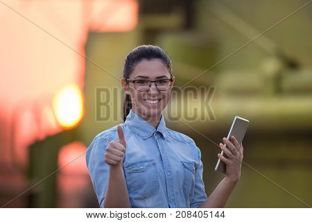 Farmer Girl With Tablet And Combine Harvester