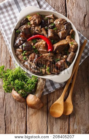 Beef Stew With Wild Mushrooms, Onion And Chili Pepper Close Up In A Bowl. Vertical Top View
