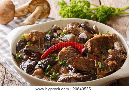 Beef Stew With Wild Mushrooms, Onion And Chili Pepper In Spicy Sauce Close-up In A Bowl. Horizontal