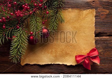 Christmas background - blank paper sheet and spruce tree on table