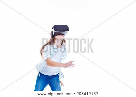 Movement is life. Happy positive energetic girl wearing 3d glasses and running while being in a virtual reality