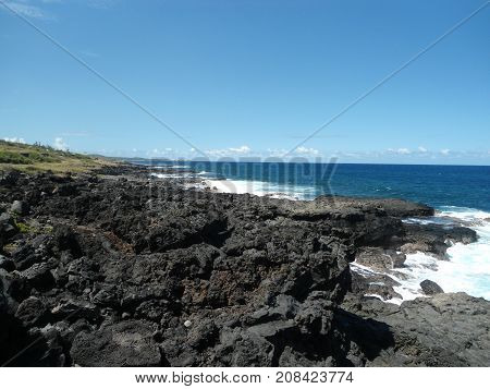 Hardened volcanic lava on beach of Indian ocean