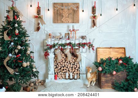 Beautiful holiday decorated room with Christmas tree, fireplace and with presents. Cozy winter scene. White interior.
