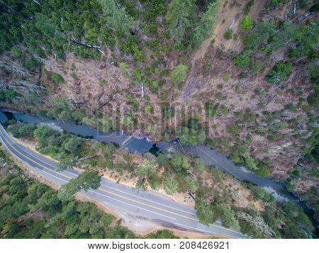 Aerial View Of Mountain Road With Forested Hills