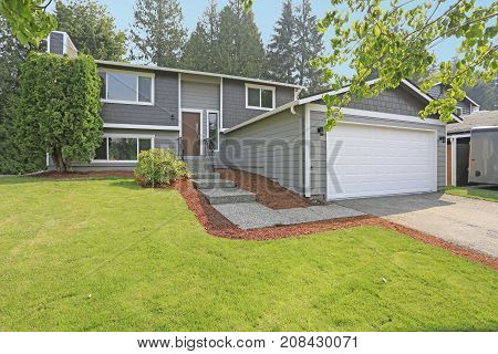 Lovely Grey Rambler House Exterior Features Grey Siding