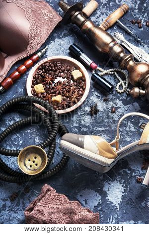 erotic concept with women's underwear hookah and coffee