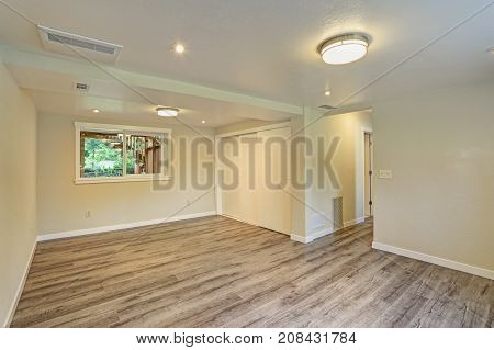 Bright Beige Large Empty Room With Hardwood Floor
