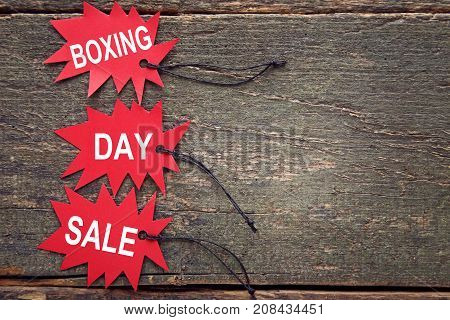 Red Sale Tags With Inscription Boxing Day Sale On Wooden Table