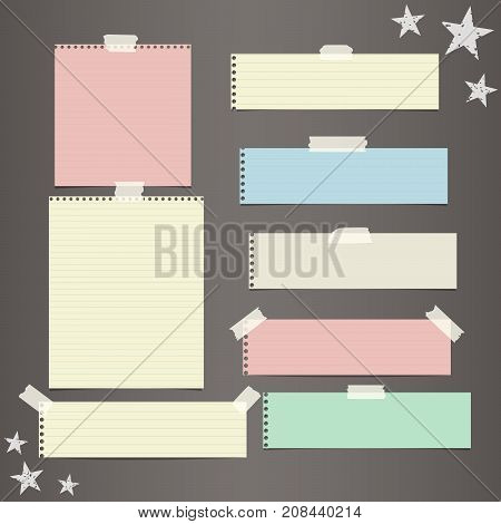 Colorful striped paper, copybook, notebook sheets for note or message stuck with sticky, adhesive tape, stars on dark brown background