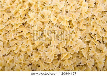 Raw bow tie pasta noodles closeup macro