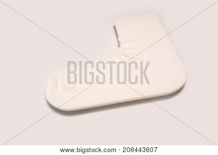 Single comfort white ankle cotton sock isolated on white background. 1st day of school concept.