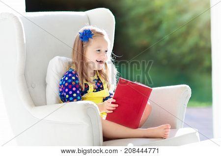 Child Reading Book. Kids Read Books.