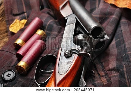 Hunting Double Barrel Vintage Shotgun, Cartridge Case On The On The Hunters Jacket In Cell, Close-up