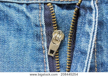 Close up Jeans Zipper pants crash. It is a serious mistake to dress.