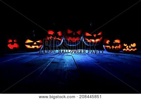 The Concept Of Halloween. Three Glowing Fiery Light Of Evil Scary Pumpkins Flying Through The Air. J