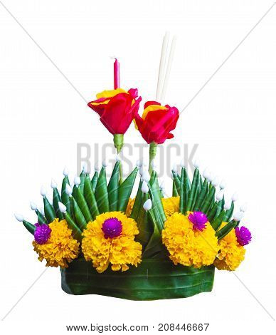 Krathong the hand crafted floating candle isolated with clipping path made of floating part decorated with green leaves colorful flowers and many sorts of creative materials.