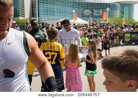Green Bay WI - August 1 2017: Green Bay Packer Ha Ha Clinton-Dix signs autographs for young fans after football practice. The community owned team has a long tradition of player involvement with fans.