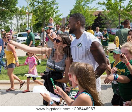 Green Bay WI - August 1 2017: Green Bay Packer DeAngelo Yancey takes selfie with a fan after football practice. The community owned team has a long tradition of player involvement with fans.