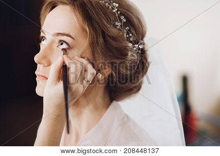 Make Up. Bride Getting On Her Make-up On By Professional Artist, Morning Preparation. Beautiful Brid
