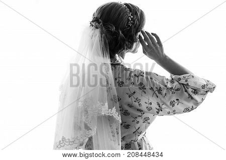 Beautiful Happy Bride Posing By The Window, Standing In Silk Robe. Happy Moments. Marriage Concept.