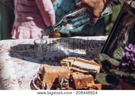 Man Pouring Vodka In Glass Closeup, Vodka Bottle At Wedding Celebration Tradition In Ukraine, Slavic