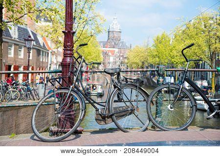 Bikes On The Bridge In Amsterdam, Netherlands.