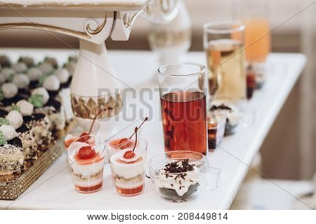 Delicious Juice And Desserts Sweet On Table At Wedding Reception In Restaurant. Luxury Catering. Chr