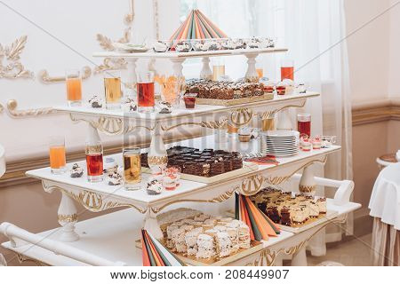 Delicious Cakes Cupcakes Juice And Desserts Sweet On Table At Wedding Reception In Restaurant. Luxur
