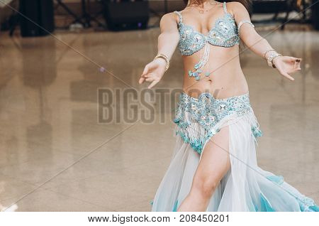 Sexual Belly Dancer.  Eastern Dancing. Woman In Blue Costume Performing Eastern Dance.  Beautiful Wo