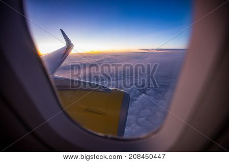 View Of The Sunset On Cloud Through The Airplane Window