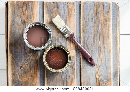 Wooden Box With Brush, And Open Cans Of Varnish And Stain