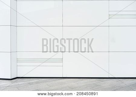 Abstract modern white ceramic tiles wall with grey ceramic tiles floor.