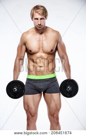 Muscular Bodybuilder Guy Doing Exercises With Big Dumbbells