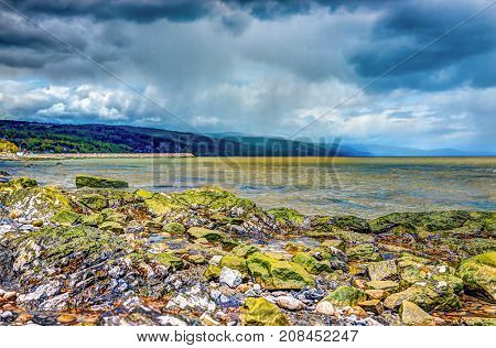 Closeup Of Green, Mossy Rocks And Saint Lawrence River In Saint-irenee, Quebec, Canada In Charlevoix