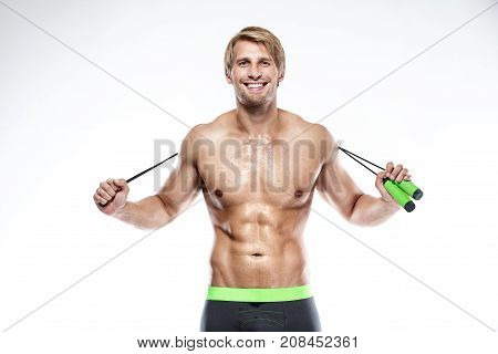 Muscular Bodybuilder Guy Doing Exercises With Jumping Rope