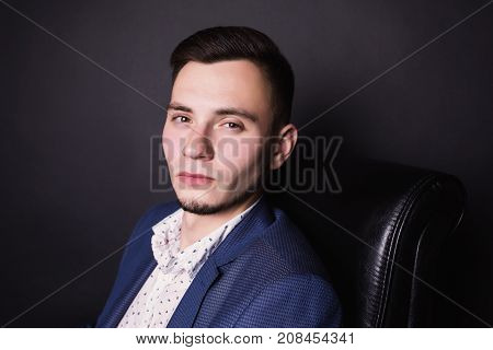 Successful business man with a business suit and white shirt. Stylish man. Man portrait. Young handsome man. Purposeful man. Man style. Man look at camera