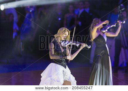 Minsk Belarus-October 7 2017: Palladium Electric Band Female Violinist Elena Polyakova Performing on WDSF International Capital Cup MinskOctober 72017 MinskBelarus.