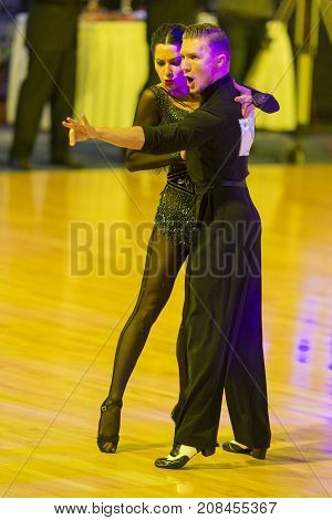 MinskBelarus-October 72017:Pro-Am Dance Couple of Yury Simachev and Oksana Kagno Performs Pro-Am Cup International Scholarship Latin-American Program on WDSF International Capital Cup Minsk in October 72017 in MinskBelarus