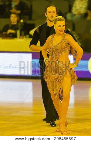 MinskBelarus-October 72017:Pro-Am Dance Couple of Iliya Kutsenko and Liliana Bolshunova Performs Pro-Am International Scholarship Latin-American Program on WDSF International Capital Cup MinskOctober 72017 MinskBelarus