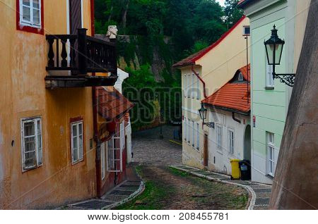 Narrow cobblestone street with colorful buildings in Europe