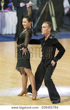 MinskBelarus-October 72017:Pro-Am Dance Couple of Dmitriy Pleshkov and Nadezhda Shcherchkova Performs Pro-Am International Scholarship Latin-American Program on WDSF International Capital Cup MinskOctober 72017 MinskBelarus