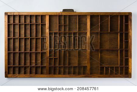 Antique Typesetter Drawer with Dividers on White Background Top View